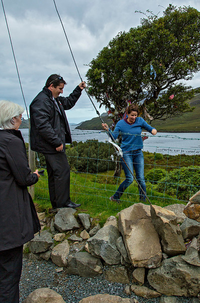 Our leader, Salomé, assisted by our driver Damian, successfully negotiates the barbed wire.