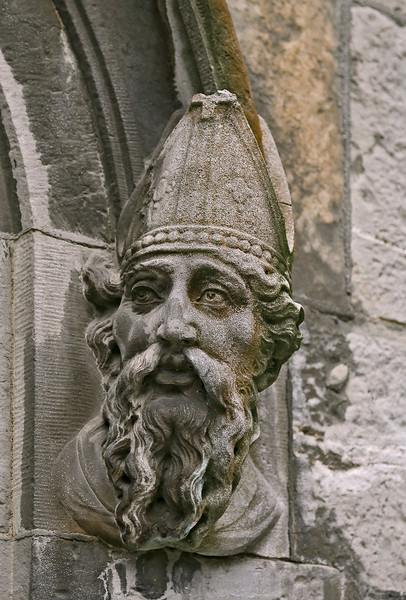 St. Patrick, above the end door of Dublin Castle, looks at Brian Boru.