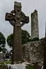 Another high cross with the round  tower in the background.