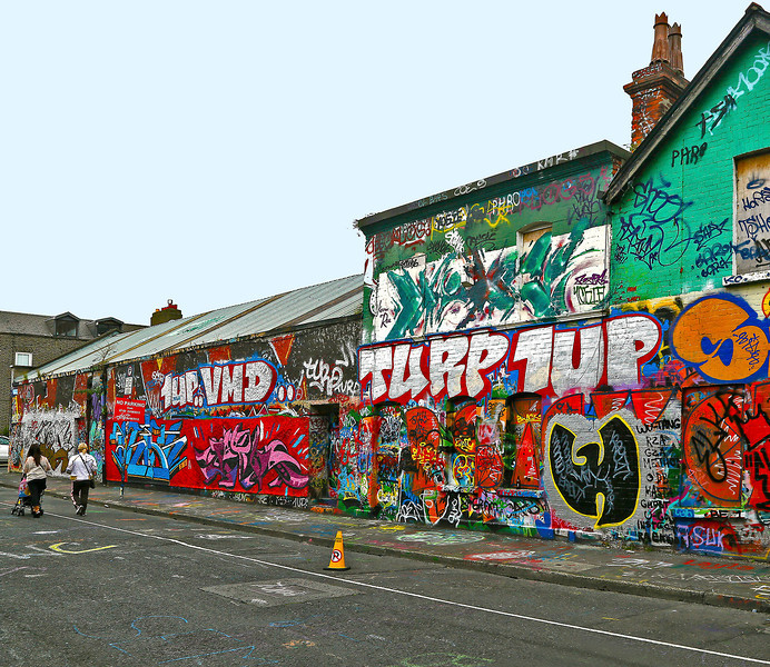Both sides of Windmill Lane are covered in graffiti.