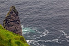 Sea stack at the Cliffs of Moher. Once part of the cliff, the erosive forces of sea and wind created an ocean-level cave.With time the top of the cave broke away leaving just this spire.