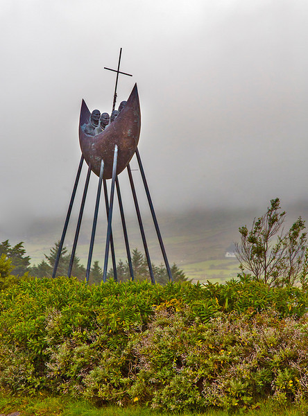 "This statue represents the monk Saint Brendon the ""Navigator."" He and 60 other monks sailed the Atlantic for seven years on a missionary quest. They reached Wales, Scotland, France, and Britain, evangelizing and building monasteries. Some believe they actually reached the North American continent."