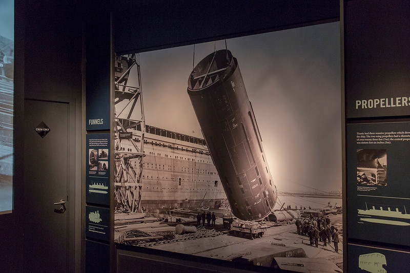 Old photo of the installation of one of Titanic's four huge funnels.