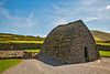 """This dry-rubble masonry structure, the """"Gallarus Oratory"""" is about 1,300 years old. Built by early Christians, it has survived Viking and Norman invasions, and the ravages of time. It is located near the south-eastern corner of Smerwick Harbor."""