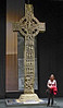In the museum in Dublin, Mary stands next to a full-size replica of one of the Irish crosses seen at Monasterboice.