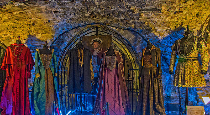 "The extensive crypt of Christ Church was used to represent the Tower of London in the TV miniseries, the ""Tudors."" Shown are several costumes used in the filming, and a portrait of the actor who portrayed Henry VIII."