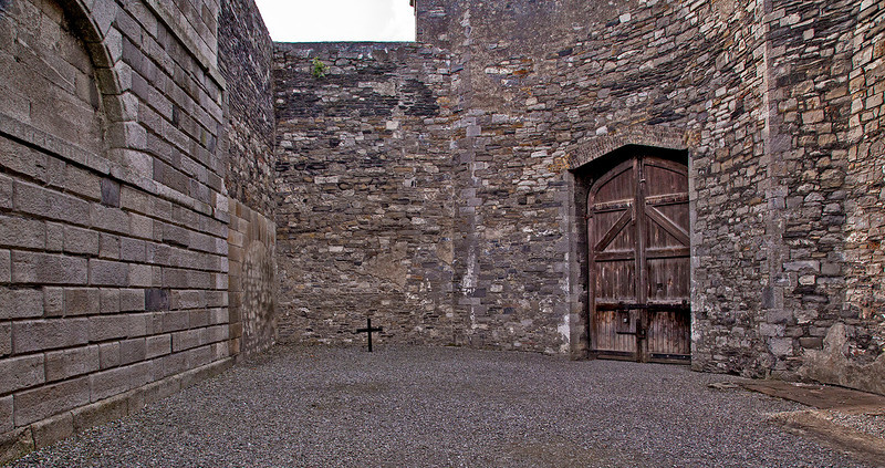 This courtyard was used for executing prisoners. The condemned would stand blindfolded at a post where the cross is located, to be shot by their British captors. There is a  second cross at the other end of the courtyard, where more were shot.