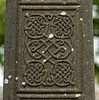 Details of an intricate pattern on the previous cross.