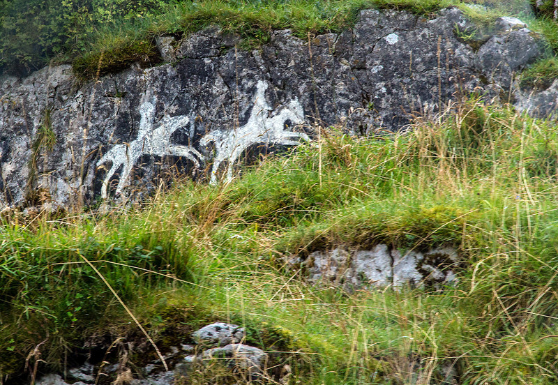 Horse figures on a roadside rock. We were told the are ancient.