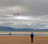 Surfing and kite flying at Inch Strand.
