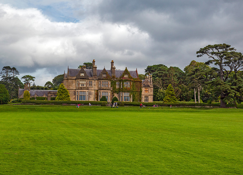 Muckross House, a 19th-century Elizabethan-style manor, is located in County Kerry.  It is adjacent to the Klllarney National Park.