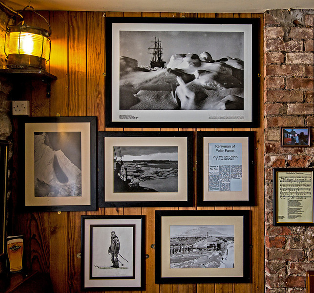 "Photos from the expedition, on the wall of the South Pole Inn. The top one showing the ""Endurance"" trapped in the ice. On the right is a ballad written to honor Crean."