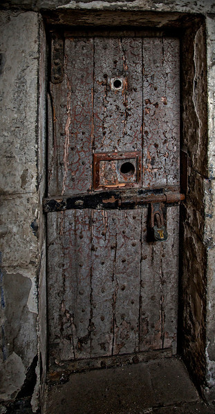 Cell door---the peep holes allowed jailers to look in any time of day or night.