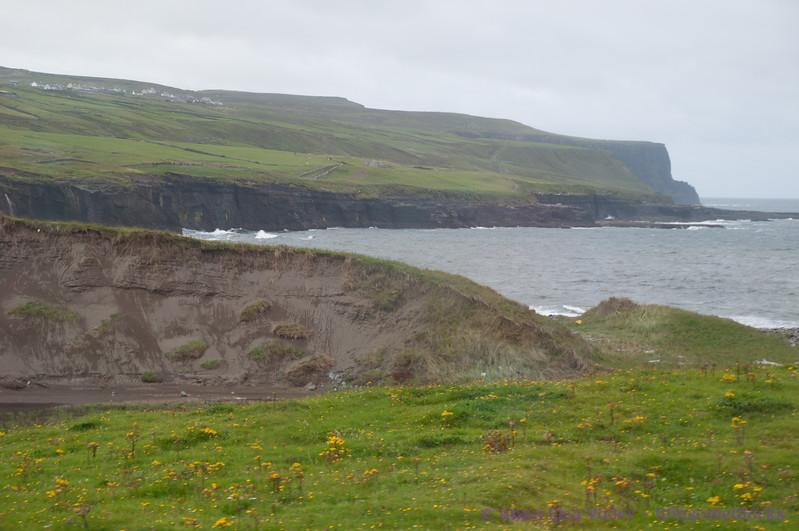 Cliffs of Moher from afar, through bus window
