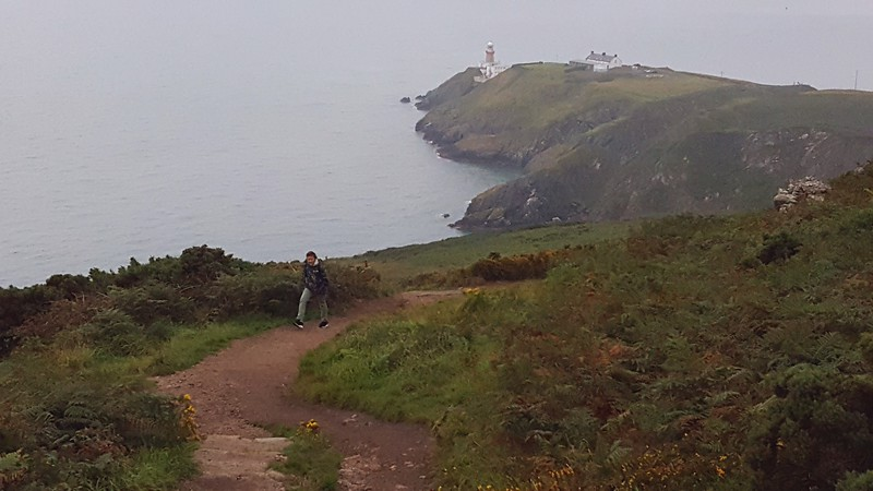 Xavier on the Howth Cliff Path -- Bailey Lighthouse in distance