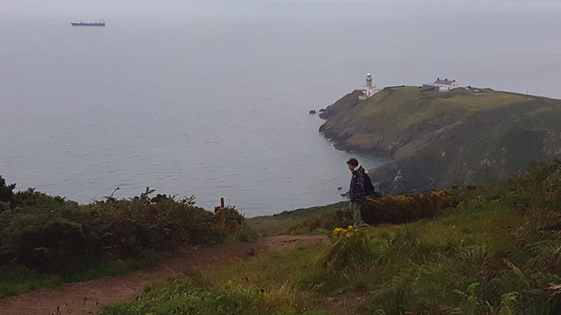 Xavier on the Howth Cliff Path -- Bailey Lighthouse in distance.