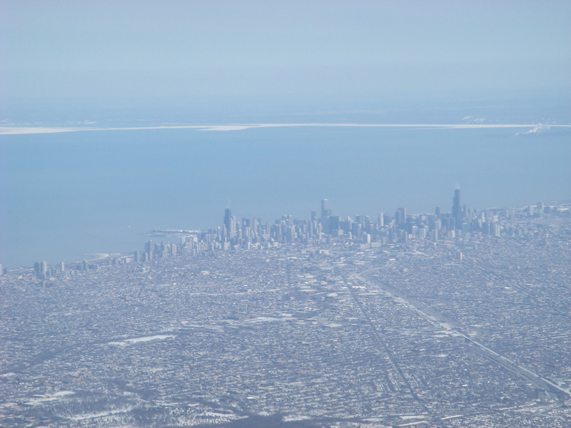 """Chicago skyline seen from the air, shortly before landing.  Want to see more?  Matt's pictures from this trip are at <a href=""""http://www.flickr.com/photos/mattglasheen/sets/72157604303851932/"""">http://www.flickr.com/photos/mattglasheen/sets/72157604303851932/</a>."""