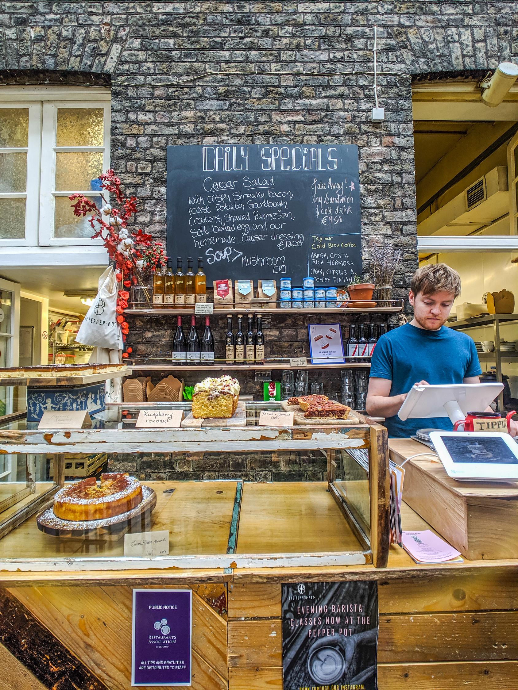 The Pepperpot cafe in Dublin Ireland menu items on chalkboard.