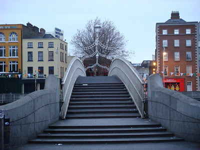 """Our flight arrived in Dublin very early the morning of March 15, before much was open, so just we walked around Dublin for a while.  This is the Ha'penny Bridge over the River Liffey.  Usability note: the """"style"""" pull-down menu on the upper right of this page provides different options for viewing this gallery.  I find the """"smugmug,"""" """"all thumbs,"""" """"slideshow,"""" and """"journal"""" options useful in different ways.  If you're poking around the photo info, my camera was still on Eastern Daylight Time, so add four hours to the time listed there for the local time where the pictures in this gallery were taken."""
