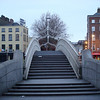 "Our flight arrived in Dublin very early the morning of March 15, before much was open, so just we walked around Dublin for a while.  This is the <a href=""http://en.wikipedia.org/wiki/Ha'penny_Bridge"">Ha'penny Bridge</a> over the River Liffey.  <b>Usability note</b>: the ""style"" pull-down menu on the upper right of this page provides different options for viewing this gallery.  I find the ""smugmug,"" ""all thumbs,"" ""slideshow,"" and ""journal"" options useful in different ways.  If you're poking around the photo info, my camera was still on Eastern Daylight Time, so add four hours to the time listed there for the local time where the pictures in this gallery were taken."