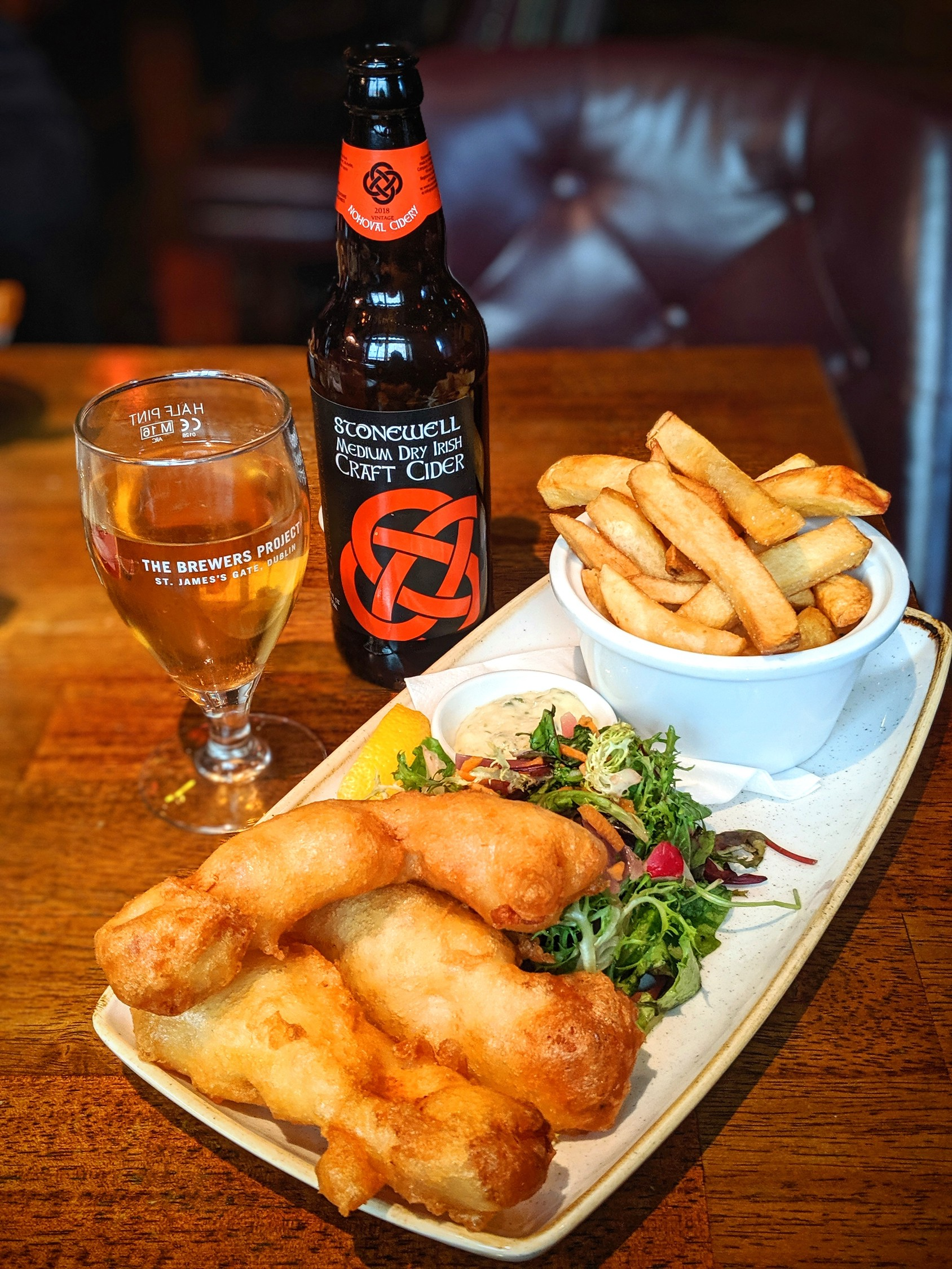 Fish and chips with local cider at Brasserie on the Corner in Galway Ireland.