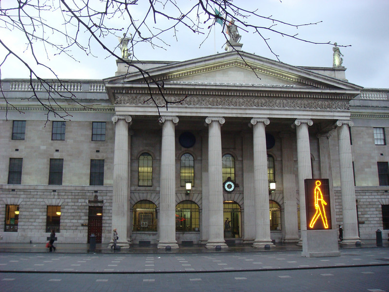 "The <a href=""http://en.wikipedia.org/wiki/General_Post_Office_(Dublin)"">General Post Office</a>.  Note the artwork by <a href=""http://www.julianopie.com/"">Julian Opie</a> in the lower right; similar works can be seen in many cities, including downtown Indianapolis."