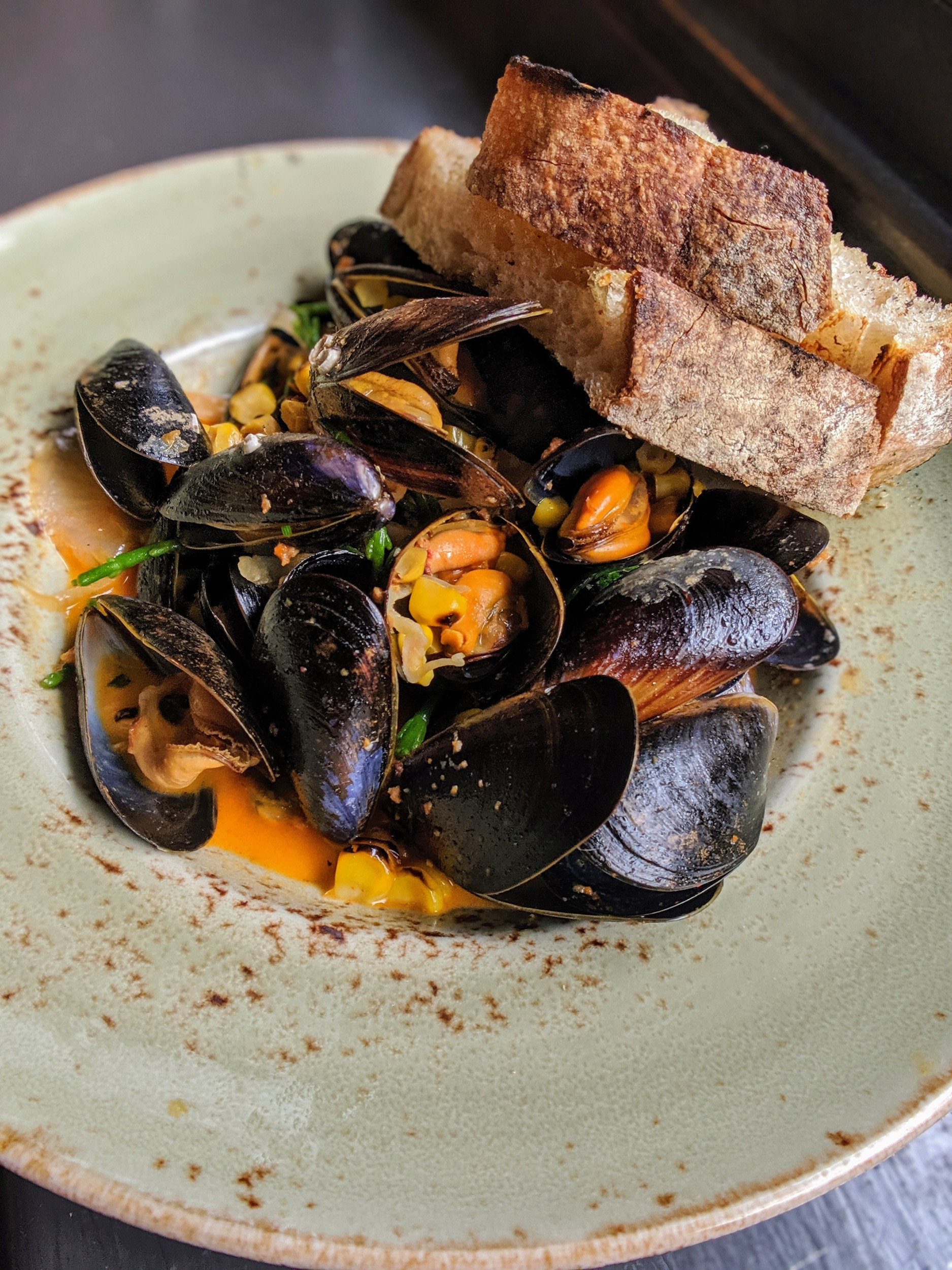 Irish mussels with nduja, sweet corn and sourdough.