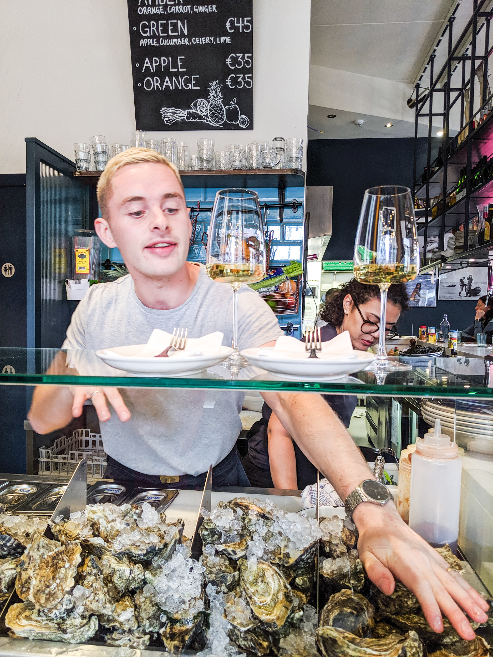 Shucker explaining oysters at a Dublin restaurant KLAW The Seafood Cafe