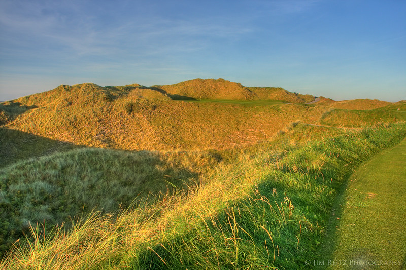 The 13th at Tralee is a par 3 over a deep ravine to a narrow shelf green on the side of a huge dune.