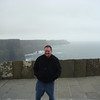 It was overcast and very windy when we were at the Cliffs of Moher.  Here I am leaning into the wind.