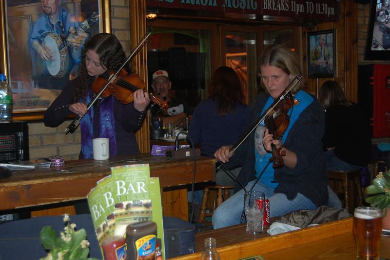 In an Irish Pub listening to some Irish music.