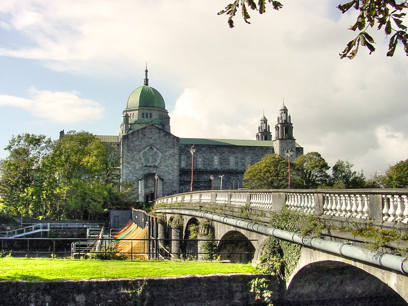Galway Cathedral (Cathedral of Our Lady Assumed into Heaven and St. Nicholas) and Salmon Weir bridge on the Corrib, Galway City