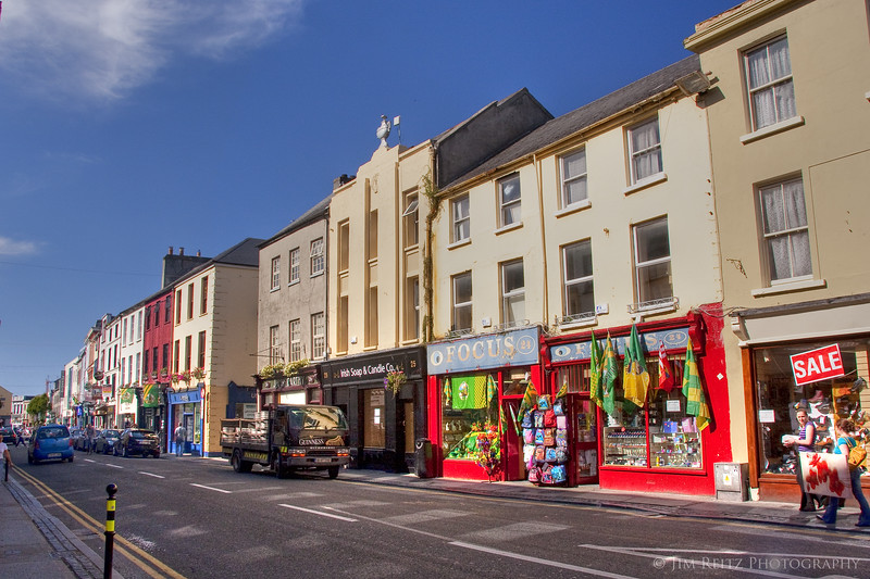 Colorful shops line the streets of Tralee town center.