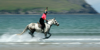 Riding on Brandon Bay strand, Dingle peninsula, County Kerry, Ireland.
