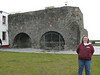 Tanya in front of the Spanish Arch, Galway, Ireland.   Dates to 1584.