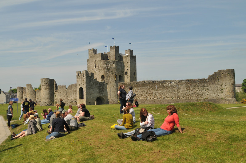 The tour group relaxing on the lawn in front of Trim Castle, waiting to board the bus back to Dublin.