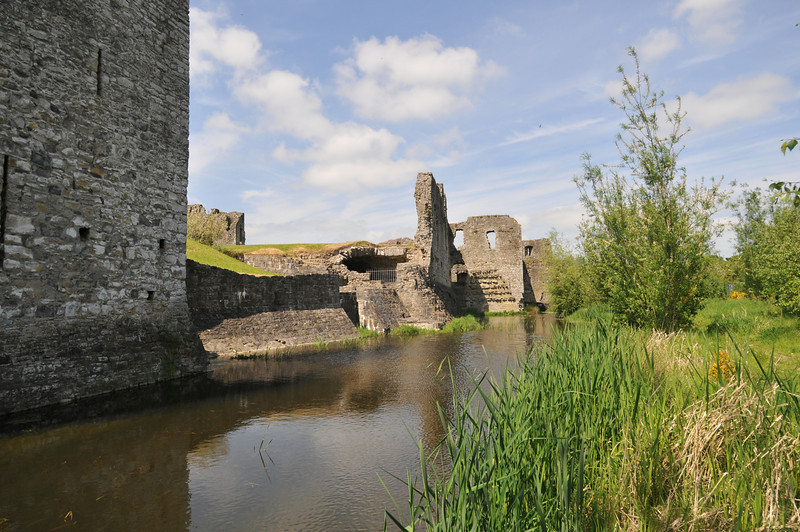 The outer wall seen from the other side of the stream / moat.
