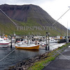 Boats docked in the marina at the Port of IsafJordur Bay, Iceland.