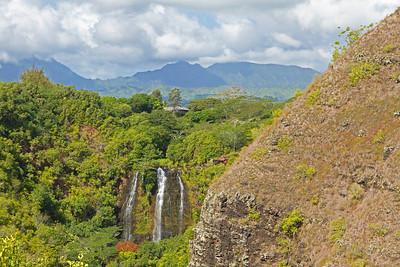 The 150 feet tall Opaekaa Falls