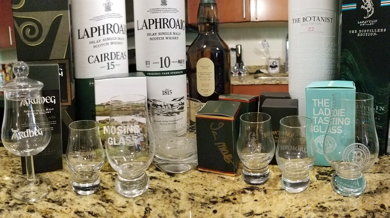 Our tasting glasses, including our Lagavulin glass signed by Iain McArthur