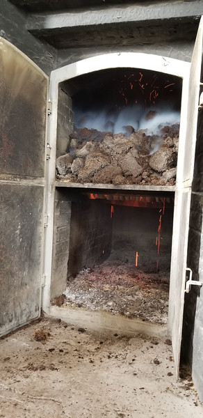 A peat kiln produces the delicious smoke that we all know and love at Laphroaig.