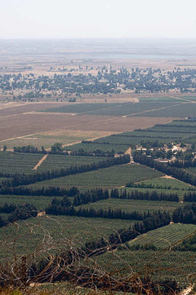 From atop the Golan Heights, looking east, Israeli farms in the foreground go all the way to the cease fire line with Syria, at the abandoned city of Kuneitra