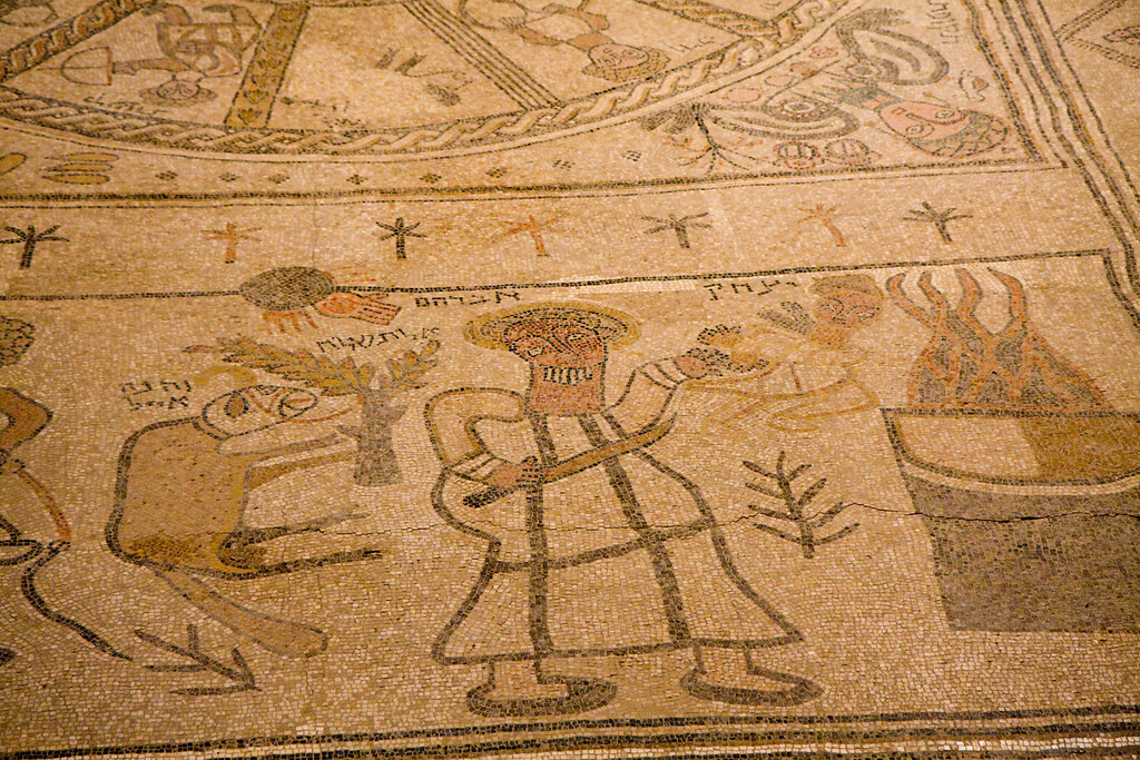 The floor mosaics are primitive - speculation is that the congregation did not have enough money to pay for top notch stuff. Here Abraham, carrying a knife, is about to sacrifice his son Isaac.