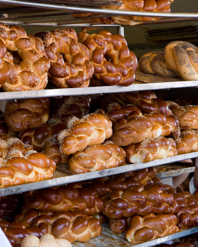 Just before Shabbat (sabbath) in the large Jewish market in the new city, hallah bread awaits buyers
