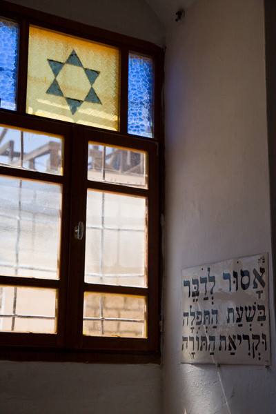 "In Safed, site of the original Kabbalah (Jewish mysticism), the sign in the synagogue says ""speaking is forbidden during prayer and reading of the Torah"""