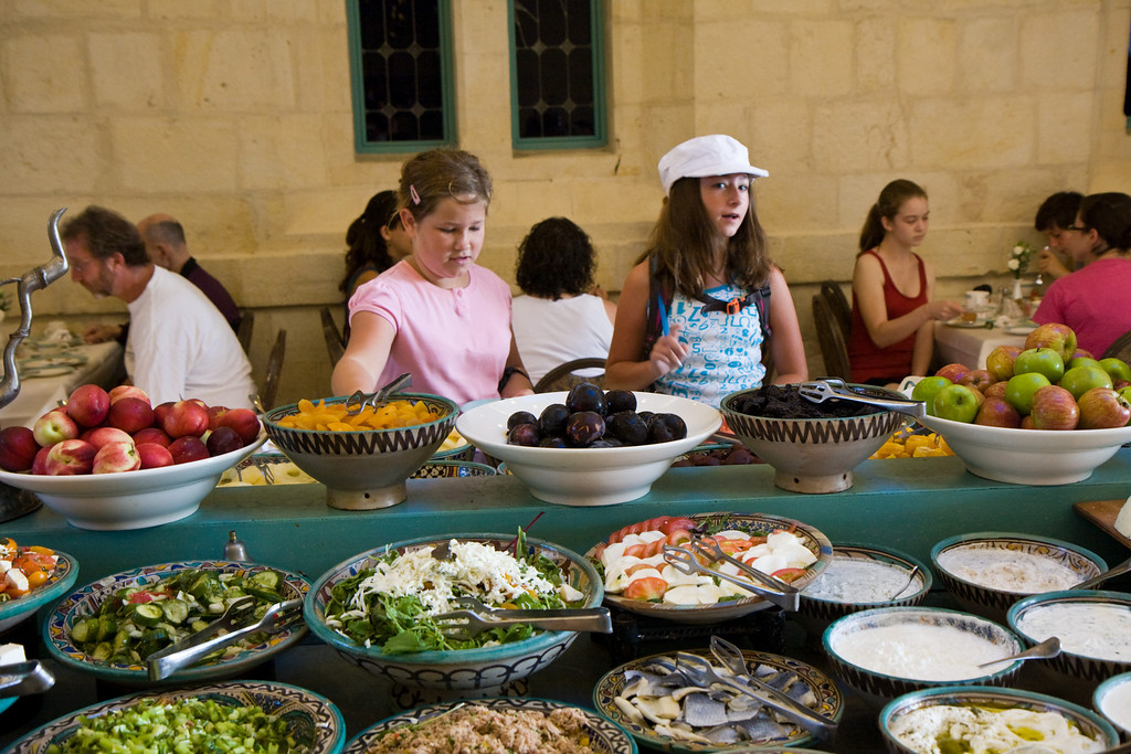 Israeli Breakfasts, with a wide variety of fresh veggies, cheeses, and breads are a hit with all of us