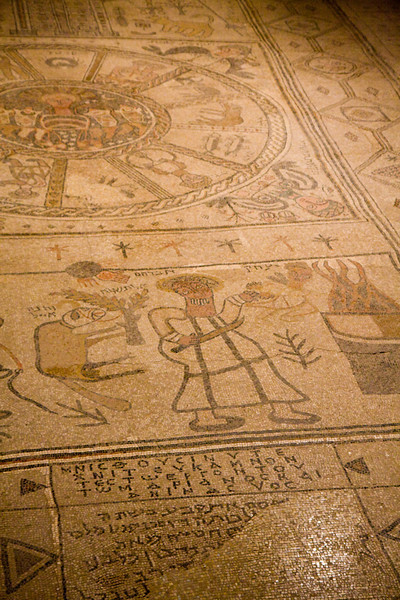 The mosaic has the sign of the zodiac. This was common at this time due to Greek influence. The writing on the floor is in Hebrew and Greek.