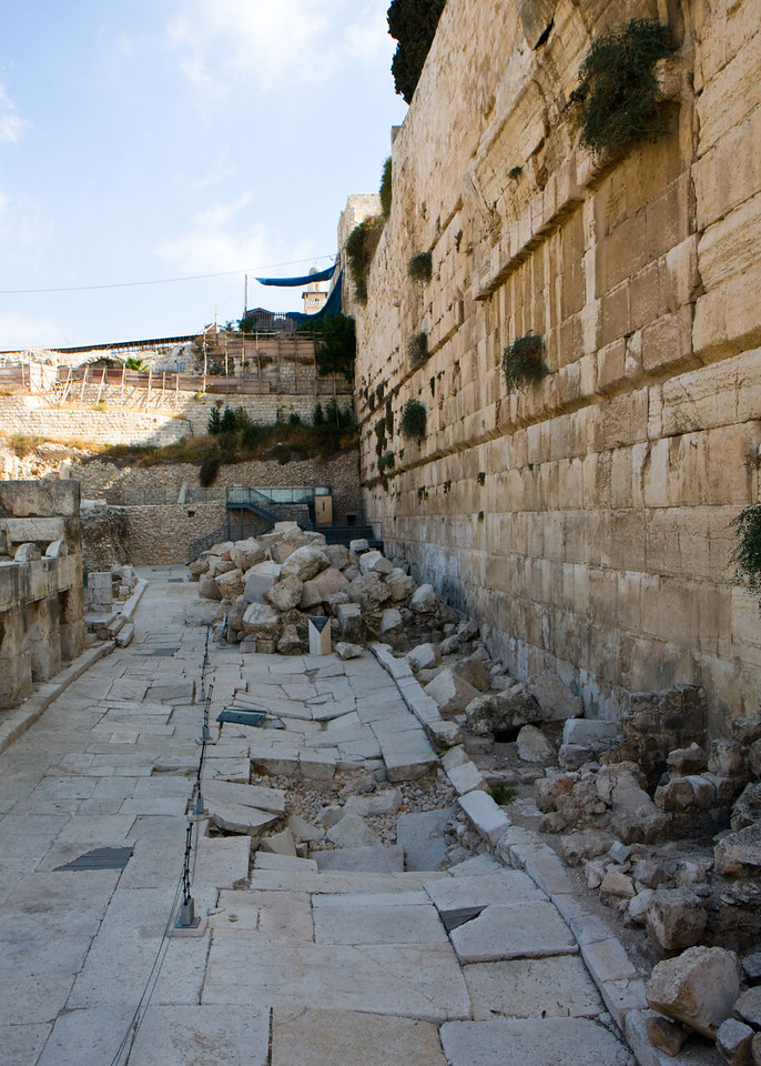 This part of the Western Wall is newly excavated. The blocks on the original road were crushed by the Romans who rolled massive blocks off of the Temple's walls, in order to destroy the Jewish Temple