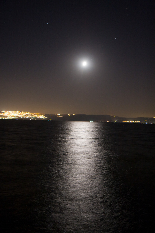 Moon over the Sea of Galilee, with the lights of Tiberias on the left
