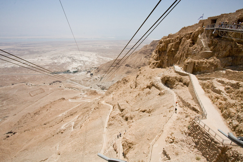 From the top of Masada, on the left are two of the Roman's camps outlined in square. On the right is the path that for thousands of years was the only way up. In the middle is the slightly more modern cable car to the top.